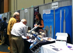 RG President, Allison Raver, assists two CDT's at the RG booth at LabDay West.